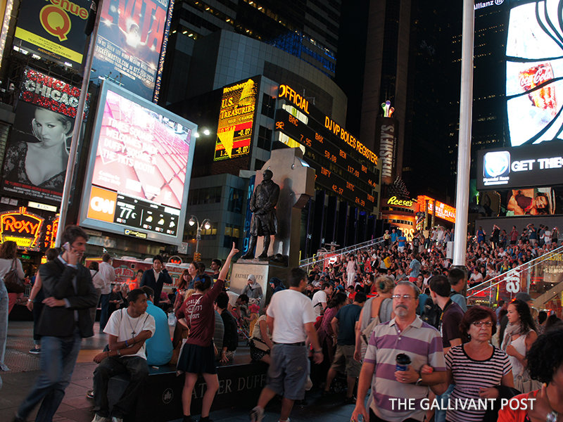 Crowded Times Square at night